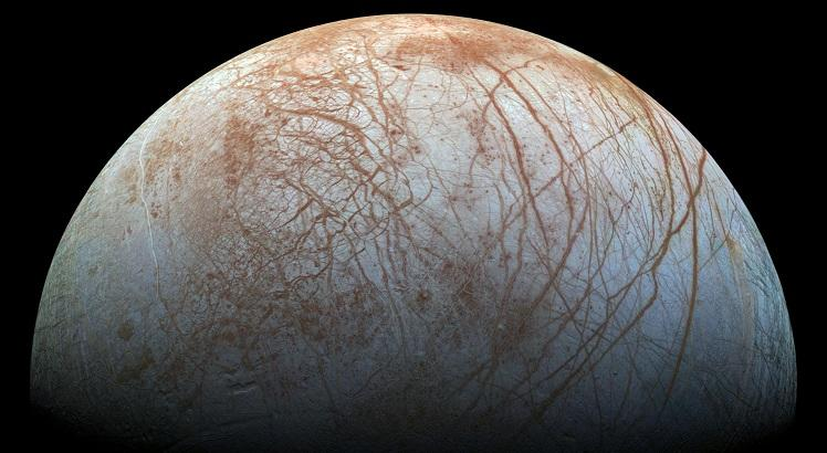 """(FILES) This NASA file photo from November 22, 2014 shows a global color view of the surface of Jupiter's icy moon Europa in this color view, made from images taken by NASA's Galileo spacecraft in the late 1990s. NASA on September 26, 2016 at a news conference at 2 pm (1800 GMT) Monday featuring Paul Hertz, NASA's director of astrophysics, and William Sparks, an astronomer with the Space Telescope Science Institute in Baltimore, is expected to announce results from a unique Europa observing campaign that resulted in surprising evidence of activity that may be related to the presence of a subsurface ocean.    - RESTRICTED TO EDITORIAL USE - MANDATORY CREDIT """"AFP PHOTO / NASA/JPL-CALTECH/SETI INSTITUTE"""" - NO MARKETING - NO ADVERTISING CAMPAIGNS - DISTRIBUTED AS A SERVICE TO CLIENTS    / AFP / NASA/JPL-Caltech/SETI Institute / Handout / RESTRICTED TO EDITORIAL USE - MANDATORY CREDIT """"AFP PHOTO / NASA/JPL-CALTECH/SETI INSTITUTE"""" - NO MARKETING - NO ADVERTISING CAMPAIGNS - DISTRIBUTED AS A SERVICE TO CLIENTS"""